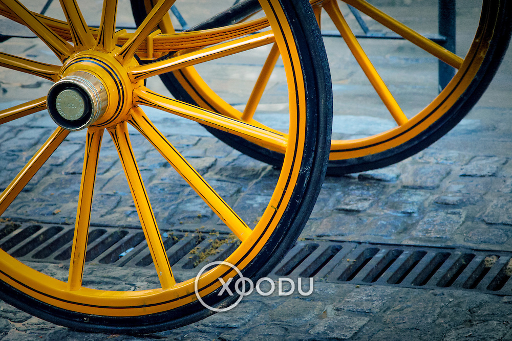Yellow horse carriage wheel spokes, Seville, Spain (January 2007)