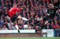 Nicky Butt (Man Utd) and Nicky Weaver (Man City). Manchester City v Manchester United. FA Premiership, 18/11/00. Credit: Colorsport / Andrew Cowie.