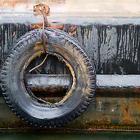 A tire used to protect a barge used on a contruction project at pier 11 ferry terminal New York City