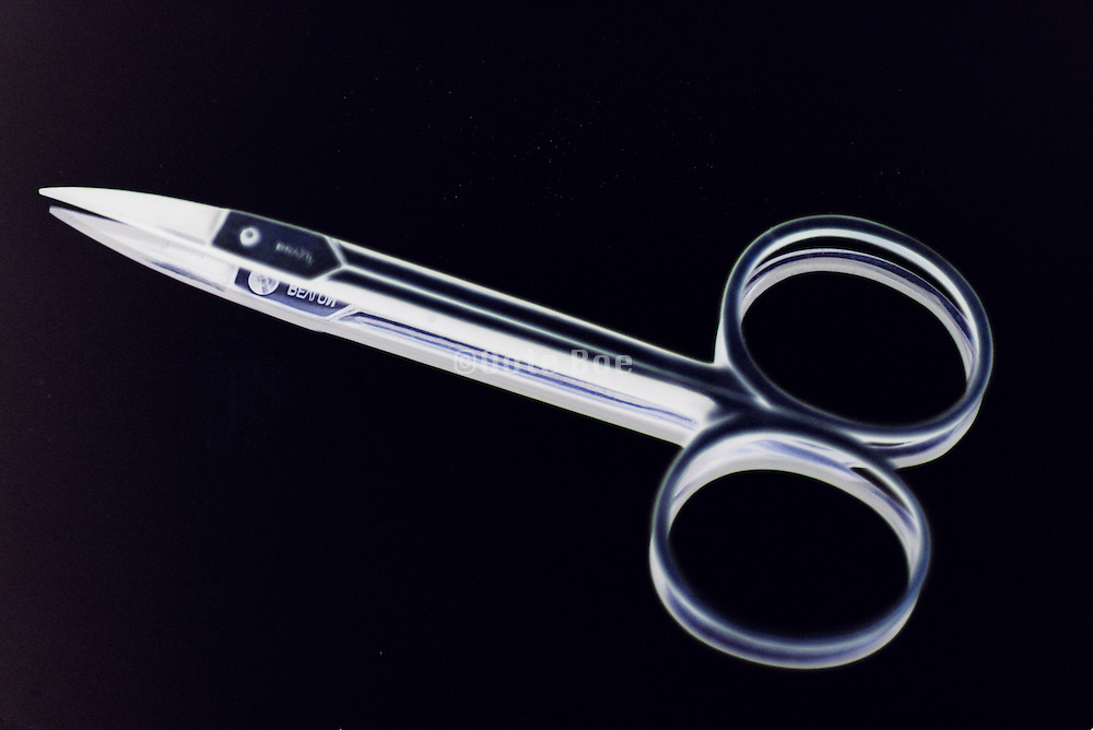 cuticle scissors on a mirror