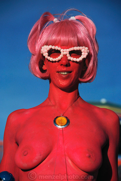 A festival participant at Burning Man. Burning Man is a performance art festival known for art, drugs and sex. It takes place annually in the Black Rock Desert near Gerlach, Nevada, USA.