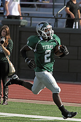 12 October 2013:  Devonte Jones strides up field during an NCAA division 3 football game between the North Park vikings and the Illinois Wesleyan Titans in Tucci Stadium on Wilder Field, Bloomington IL
