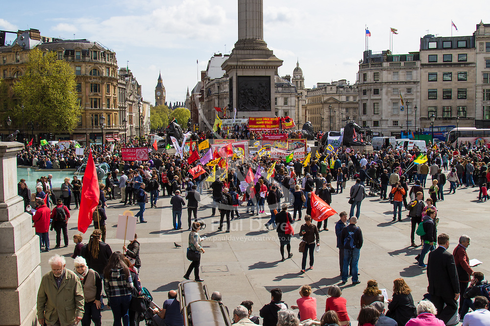 London, May 1st 2015. Hundreds of workers and Trade Unionists from across the UK are joined by Turks, Kurds and anti-capitalists as they march through London on May Day. PICTURED: The march arrives in Trafalgar Square.
