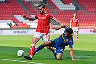Marlon Pack (21) of Bristol City is tackled by Fraizer Campbell (25) of Hull City during the EFL Sky Bet Championship match between Bristol City and Hull City at Ashton Gate, Bristol, England on 21 April 2018. Picture by Graham Hunt.