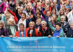 Pictured: Women ministers and supporters march into the quad of the General Assembly, led by former Moderator the Reverend Lorna Hood, where they are joined by the Moderator the Right Reverend Susan Brown.<br /> <br /> Women ministers and supporters processed up the Mound in Edinburgh to the General Assembly of the Church of Scotland to mark 50 years since the Church allowed the ordination of women.<br /> <br /> © Dave Johnston / EEm