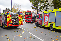 Ladbroke Grove, London, November 17th 2016. A double decker bus crashes into Kensal House on Ladbroke Grove prompting a major response from the emergency services including the air ambulance. According to Detective Chief Superintendent Ellie O'Connor of Met Police Kensington and Chelsea, 14 people including the driver were hurt, with none sustaining life-threatening or life changing injuries. Police officers would not speculate on the cause of the accident, but apologised for delays and commended all branches of the emergency services for their prompt and efficient response. The bus will be towed away for further investigations. PICTURED: The bus crashed into a residential apartment block, Kensal House.