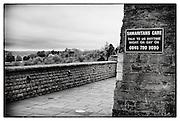 Clifton Suspension Bridge, Bristol, with Samaritans sign on wall.