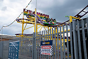 Riders on the Wild Mouse rollercoaster ride at Digbeth fun fair on 3rd August 2021 in Birmingham, United Kingdom. Digbeth fun fair offers all sorts of fairground rides and attractions less than a mile from the city centre.