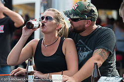Enjoying Main Street Station on Main Street during the 2015 Biketoberfest Rally. Daytona Beach, FL, USA. October 16, 2015.  Photography ©2015 Michael Lichter.