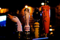 A variety of beer taps at The American Retro Bar & Grille in the Hell's Kitchen section of NYC, NY.