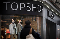 © Licensed to London News Pictures. 30/11/2020. London, UK. A man walks past the shop front of a Topshop store on Oxford Street in London. Arcadia Group, the parent company of retail outlets Top Shop, Burton, Dorothy Perkins, Evans and Miss Selfridge, is close to going in to administration, putting putting 13,000 jobs at risk, following the economic affects of coronavirus lockdown. Photo credit: Ben Cawthra/LNP