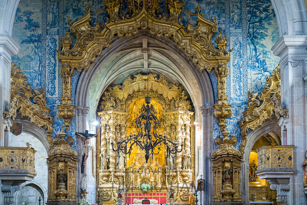 Church of Saint Francis with ornate gilt and azulejos tiles above the altar in Guimaraes in Portugal
