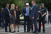 The American Ambassador to the UK, Robert Wood 'Woody' Johnson IV in the white cap inspects security with his staff outside Winfield House, his official residence during the visit to the UK of US President, Donald Trump, on 12th July 2018, in Regents Park, London, England.
