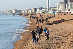 © Licensed to London News Pictures. 02/01/2017. Brighton, UK. Members of the public take to the beach in Brighton and Hove as sunny and dry weather is hitting the seaside resort. Photo credit: Hugo Michiels/LNP