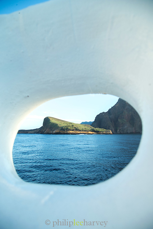 Isabella island in the distance as seen from a cruise ship. Galapagos Islands, Ecuador, South America