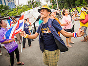 05 AUGUST 2013 - BANGKOK, THAILAND: An anti-government protestor dances at a rally in Bangkok. About 500 people, members of the  People's Army against Thaksin Regime, a new anti-government group, protested in Lumpini Park in central Bangkok. The protest was peaceful but more militant protests are expected later in the week when the Parliament is expected to debate an amnesty bill which could allow Thaksin Shinawatra, the exiled former Prime Minister, to return to Thailand.    PHOTO BY JACK KURTZ
