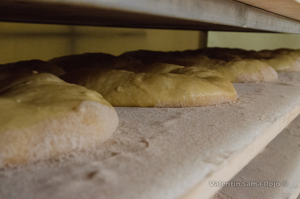 Big ring-shaped pastries made for the festivities honoring St. Juan Lorenzo ready to be baked.