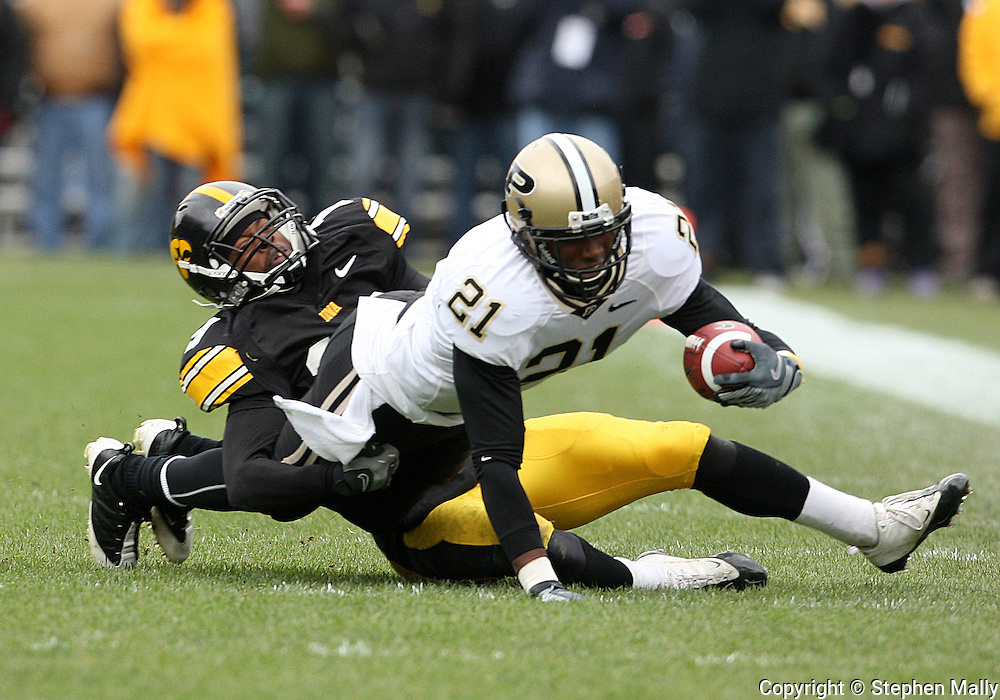 15 NOVEMBER 2008: Purdue wide receiver Greg Orton (21) tries to get away from Iowa defensive back Amari Spievey (19) in the second half of an NCAA college football game against Purdue, at Kinnick Stadium in Iowa City, Iowa on Saturday Nov. 15, 2008. Iowa beat Purdue 22-17.