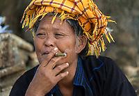INLE LAKE, MYANMAR - CIRCA DECEMBER 2013: Burmese woman smoking in the Taung Tho Market in Inle Lake, Myanmar