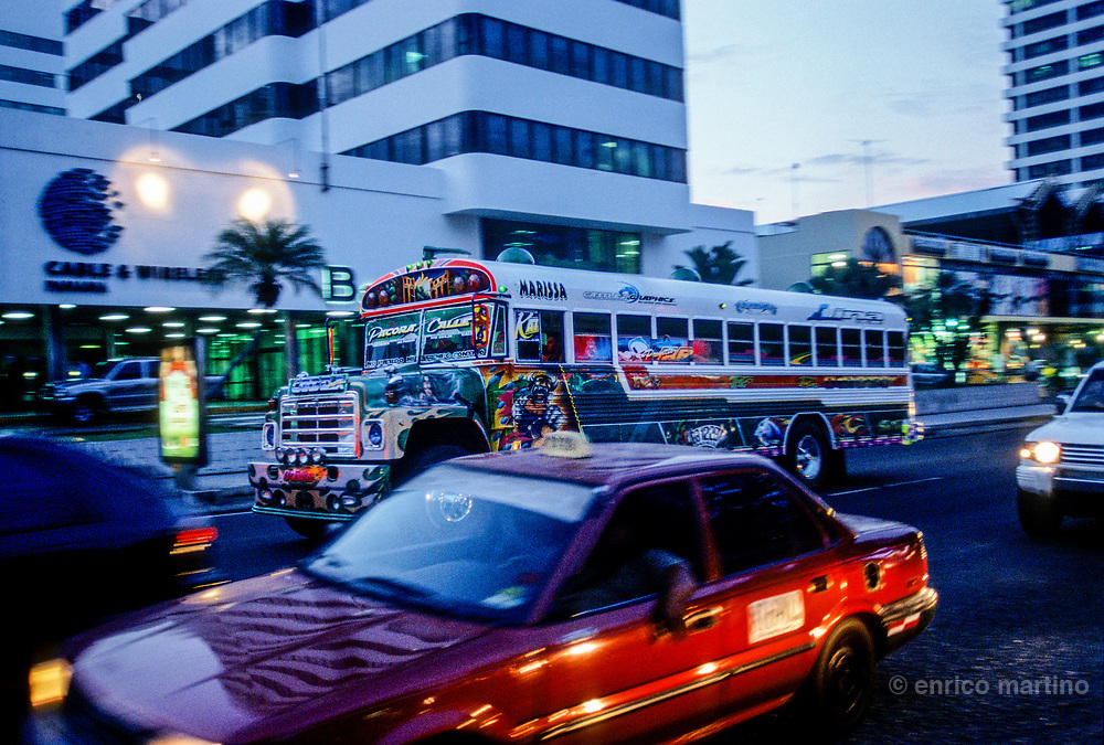 The creatively painted Diablos Rojos bus (Red Devils) every day still travel the streets of Panamà with their low fares. This fleet of school buses, creatively transformed into works of art by their owners, are a unique aspect of Panamà City, a true cultural experience. Many buses have paintings of religious icons, pop culture heroes, actresses, sport stars, politicians. The drivers choose their own routes and on the front of the bus is usually painted the destination. Music at high volume, poor ventilation and lack of security transform the buses in a uncomfortable transport system. Panamà's governement is trying the put end to the legend of Diablos Rojos but Panamà expresses its popular culture through the bus painting, in the way murals do for other cities, so this expression of popular art could end in few years.
