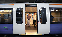 Passengers on board the first Elizabeth Line train as it enters service travelling from Liverpool Street station in London to Shenfield in Essex.