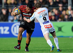 Saracens Prop (#1) Mako Vunipola is tackled by Exeter Chiefs Scrum-Half (#9) Will Chudley during the first half of the match - Photo mandatory by-line: Rogan Thomson/JMP - Tel: Mobile: 07966 386802 16/02/2013 - SPORT - RUGBY - Allianz Park - Barnet. Saracens v Exeter Chiefs - Aviva Premiership. This is the first Premiership match at Saracens new home ground, Allianz Park, and the first time Premiership Rugby has been played on an artificial turf pitch.