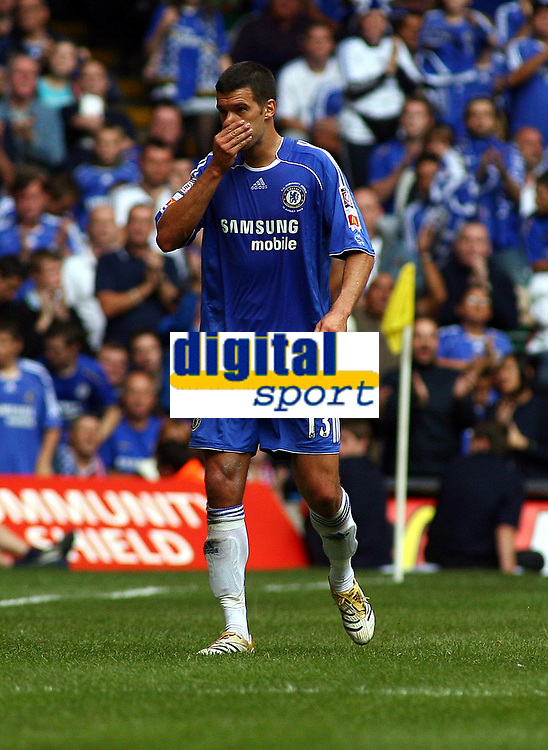 An Unhappy Michael Ballack is substituted after Hip Injury<br />Chelsea 2006/07<br />Chelsea V Liverpool (1-2) The FA Community Shield at the Millenium Stadium in Cardiff 13/08/06<br />Photo Robin Parker Fotosports International