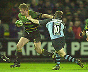 Photo Peter Spurrier<br /> 07/12/2002<br /> European Rugby - Heineken Cup Northamton vs Cardiff.<br /> Mark Soden push's off  Iestyn Harris as Saints attach the Cardiff defence.