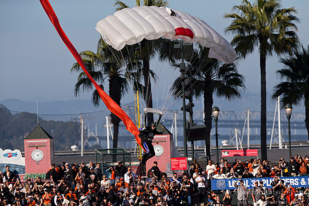 SAN FRANCISCO, CA - APRIL 18:  Skydivers deliver San Francisco Giants World Series rings into the stadium by parachute during the 2014 World Series ring ceremony before the game against the Arizona Diamondbacks at AT&T Park on April 18, 2015 in San Francisco, California.  The San Francisco Giants defeated the Arizona Diamondbacks 4-1. (Photo by Jason O. Watson/Getty Images) *** Local Caption ***