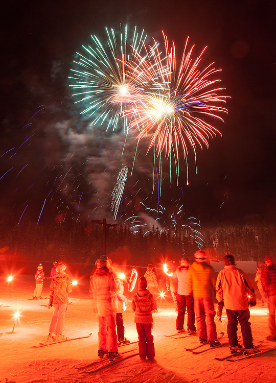 Fireworks light up the sky following a torchlight parade down Freeway on New Year's Eve at Monarch Mountain.