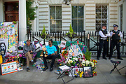 Two police officers stand nearby as the husband of detained Nazanin Zaghari Ratcliffe, Richard Ratcliffe, far left continues his hunger strike outside the Iranian Embassy in Knightsbridge, London, United Kingdom on 27th June 2019. Mr Ratcliffe began his protest on June 15 at the same time his wife went on hunger strike in Iran, where she has been detained in prison since April 2016.