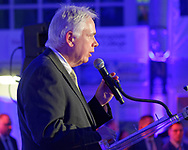 Garden City, New York, U.S.  November 14, 2019. L-R, ANDREW PARTON, President of Cradle of Aviation, is speaking at podium during the 17th Annual Cradle of Aviation Museum Air and Space Gala, in Long Island.
