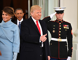 President-elect Donald Trump and wife Melania arrive at the White Houseas President Barak Obama looks on before the inauguration on January 20, 2017 in Washington, D.C. Trump becomes the 45th President of the United States. Photo by Kevin Dietsch/UPI/POOL/ABACAPRESS.COM