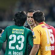 Referee's Bunyamin GEZER (C) during their Turkish Super League soccer match Galatasaray between Bursaspor at the AliSamiYen Stadium at Mecidiyekoy in Istanbul Turkey on Sunday 25 April 2010. Photo by Aykut AKICI/TURKPIX