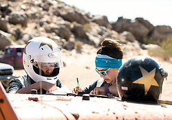 October 17, 2018 - Johnson Valley, California, U.S. - KYOUKA, left, and ASHLEY LEE of Team Sexy Jeep plot their navigation on Day 5 of the third annual Rebelle Rally, the first women's off-road navigation rally in the United States. The event features a unique scoring system in which precise navigation - not speed - is the ultimate goal.  With cell phones and GPS devices banned during the 10-day event, and armed with just maps, compasses and roadbooks, 43 two-person teams are tasked with scoring points based on time, distance and hidden checkpoints as they make their way across 1,600 miles of scrub brush, sand dunes and boulders in the Nevada and California desert.(Credit Image: © Brian Cahn/ZUMA Wire)