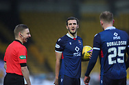 Alex Iacovitti of Ross County and Coll Donaldson of Ross County share a joke with the Assistant referee, Calum Spence,  during the Scottish Premiership match between Livingston and Ross County at Tony Macaroni Arena, Livingston, Scotland on 10 January 2021.