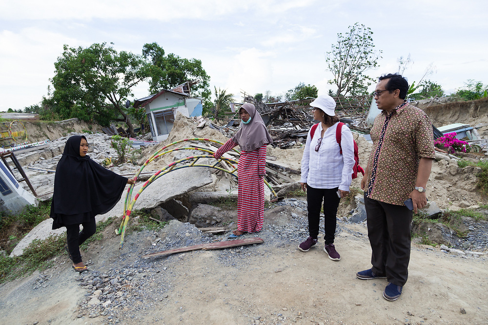 November 30, 2018. ADB staff, Ibu Syarifah Aman-Wooster, Principal Safeguard Specialist and Pak Sutarum Wiryono, Senior Project Officer talk to residents of Petobo, a village that was swallowed by a sinkhole or Liquefaction triggered by an earthquake of 7.5 earthquake magnitude that hit off the coast of Donggala, Palu Sulawesi Central, Indonesia on Sept. 28, 2018. About 1,700 houses were buried by mud. (ADB Photo, Andri Tambunan)