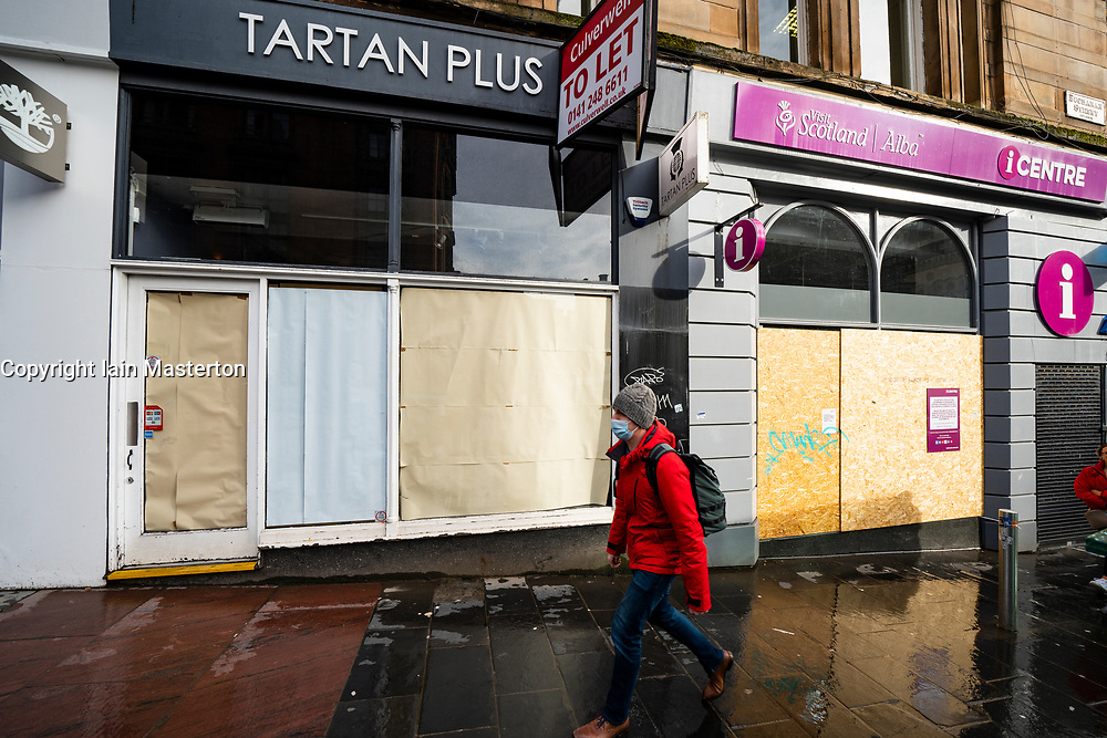 Glasgow, Scotland, UK. 12 March 2021. On the day Covid-19 lockdown is relaxed slightly in Scotland the city centre streets in Glasgow city centre remain almost deserted virtually all shops ad cafes are still closed. Pic;  Tourist gift shop and travel centre on Buchanan Street are closed and boarded up. Iain Masterton/Alamy Live News