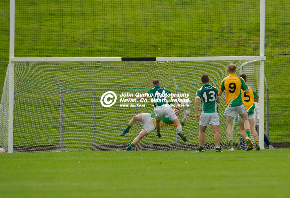 08-09-19. Clann na nGael v Moylagh  - A FL Div.4 Final  at Pairc Tailteann.<br /> Clann na nGael goalkeeper Eoin Griffin making a spectacular save from Tommy O'Reilly's shot.<br /> Photo: John Quirke / www.quirke.ie<br /> ©John Quirke Photography, Unit 17, Blackcastle Shopping Cte. Navan. Co. Meath. 046-9079044 / 087-2579454.
