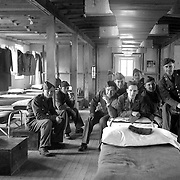 Soldier's from the 71st Battalion pose for a photograph in their barracks. Al Mozell in center, rear. Others unidentified.