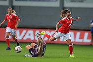Grace Moloney, the Rep of Ireland goalkeeper saves from Natasha Harding of Wales.Friendly International Womens football, Wales Women v Republic of Ireland Women at Rodney Parade in Newport, South Wales on Friday 19th August 2016.<br /> pic by Andrew Orchard, Andrew Orchard sports photography.