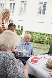 Senior man giving gift to his wife, Bavaria, Germany