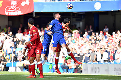 Chelsea's Olivier Giroud scores his side's first goal of the game with a header during the Premier League match at Stamford Bridge, London.