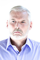 caucasian senior man portrait pucker displeased isolated studio on white background