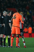 Football - 2017 / 2018 Premier League - Southampton vs. Liverpool<br /> <br /> Virgil van Dijk of Liverpool embraces Southampton's Ryan Bertrand after the final whistle at St Mary's Stadium Southampton<br /> <br /> COLORSPORT/SHAUN BOGGUST