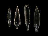 Black obsidian arrow heads. Catalhoyuk Collections. Museum of Anatolian Civilisations, Ankara. Against a black background .<br /> <br /> If you prefer you can also buy from our ALAMY PHOTO LIBRARY  Collection visit : https://www.alamy.com/portfolio/paul-williams-funkystock/prehistoric-neolithic-art.html - Type Catalhoyuk into the LOWER SEARCH WITHIN GALLERY box. Refine search by adding background colour, place, museum etc.<br /> <br /> Visit our PREHISTORIC PLACES PHOTO COLLECTIONS for more  photos to download or buy as prints https://funkystock.photoshelter.com/gallery-collection/Prehistoric-Neolithic-Sites-Art-Artefacts-Pictures-Photos/C0000tfxw63zrUT4