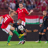Hungary's Vladimir Koman (L) and Netherlands' Jeremain Lens (bottom C) fights for the ball during the World Cup 2014 qualifying soccer match Hungary playing against Netherlands in Budapest, Hungary on September 11, 2012. ATTILA VOLGYI