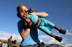 Embargoed to 0001 Sunday December 18 File photo dated 18/12/14 of Prince Harry swinging three year old orphan Lerato during a visit to Phelisanong Children's Home in Maseru, Lesotho, as Harry has made a new documentary about Lesotho - 12 years after he first took part in a film about the Aids-stricken southern African nation.