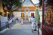 27 JANUARY 2013 - BANGKOK, THAILAND:   The entrance to Dhevasathan (the Brahmin Shrines) on Dinso Rd in Bangkok during the Hindu / Brahmin holy day of Thaipusam. Thaipusam is a Hindu festival celebrated primarily by the Tamil community in South East Asia on the full moon in the Tamil month of Thai (Jan/Feb). Pusam refers to a star that is at its highest point during the festival. The festival commemorates both the birthday of the Hindu god Murugan, son of Shiva and Parvati, and the occasion when Parvati gave Murugan a vel (a lance) so he could vanquish the evil demon Soorapadman. The holy day is celebrated by Brahmins in Thailand. Brahmanism was the court religion before Buddhism came to Thailand and before the foundation of Sukhothai. Both religions are combined in the Thai way of life and its customs and ceremonies.       PHOTO BY JACK KURTZ
