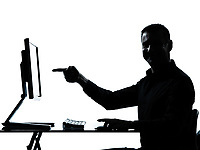 one caucasian business man pointing gesture computer computing silhouette in studio isolated on white background